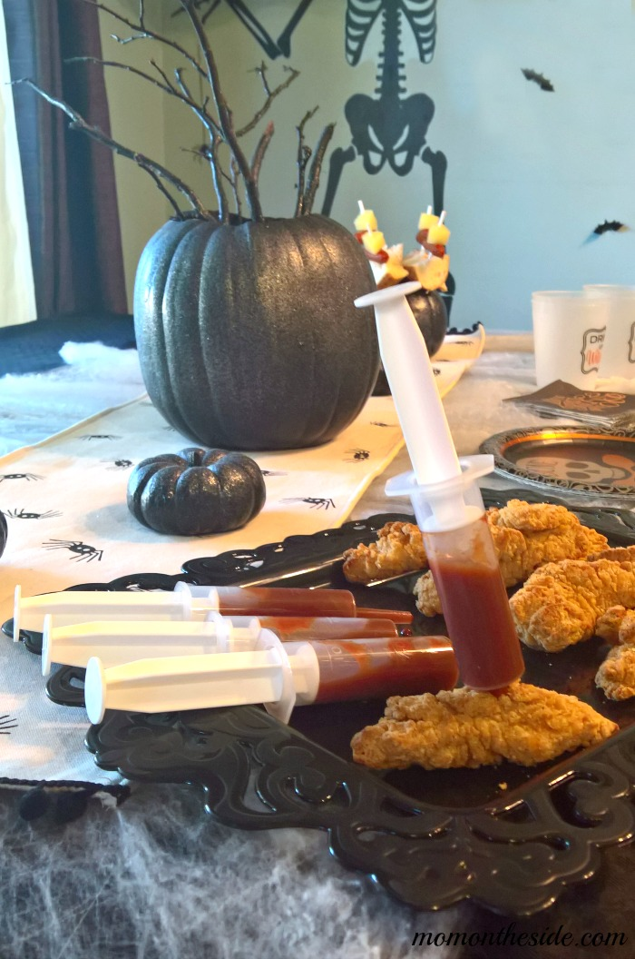 Check out this Adult Halloween Party Tablescape Under $40, with Halloween Party food ideas! See how easy it is to create on Mom on the Side!
