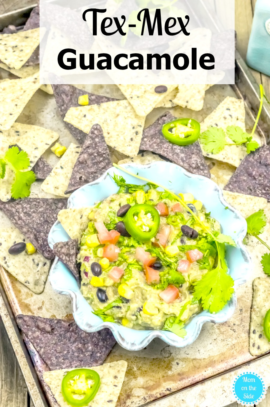 This delicious Tex-Mex Guacamole recipe is easy to mix together with a kick of a taste. Pair with tortilla or pita chips for your next party!