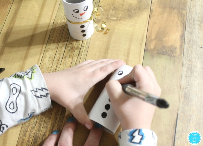 Decorating DIY Toilet Paper Tube Snowmen